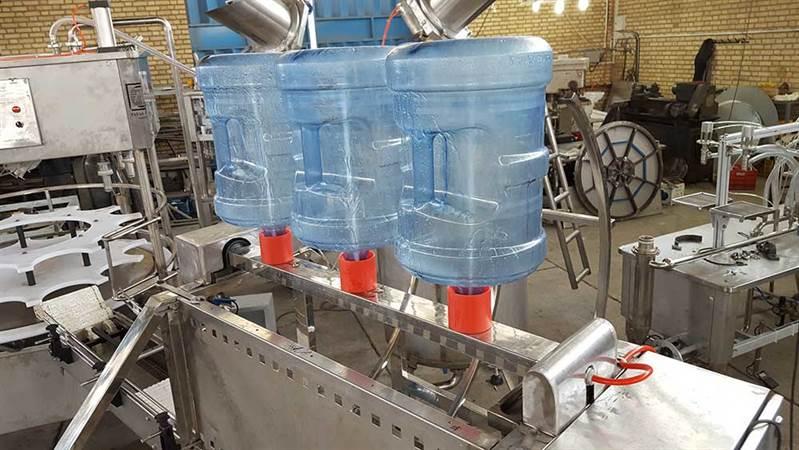 دستگاه پرکن گالن آب یاسرد کن تری بلوک