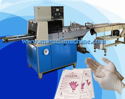 دستگاه بسته بندی دستکش جراحی از نوع دستگاه بسته بندی چهار طرف دوخت می باشد.